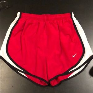 Red Nike DriFit shorts
